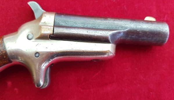 A scarce American Colt no 3.  rim-fire derringer in obsolete .41 rimfire calibre. C.1875. Ref 1579..